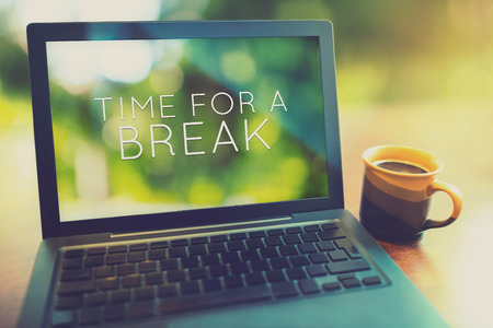 computer screen: Coffee break at morning concept with laptop serene morning vintage editing style