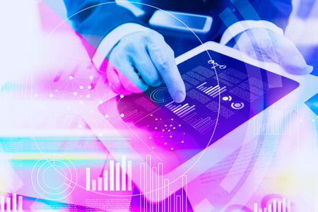 Colorful concept of a businessman working with digital tablet at office with virtual interface Stock Photo