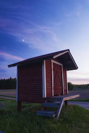 Old milk churn stand (maitolaituri) in rural countryside, Kouvola, Finland