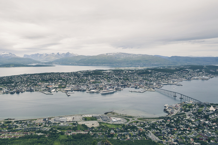 Above view of Tromso city in Northern Norway, cityscape from high Floya Hill at cloudy day. Stockfoto