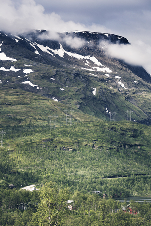 Mighty mountains in Lofoten, Norway. Electric lines crossing mountains.