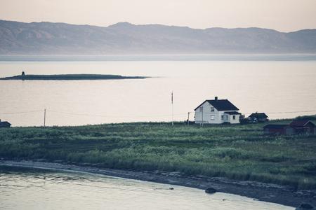 Farm countryside at summer evening in arctic Varanger Peninsula, Finnmark, Norway.