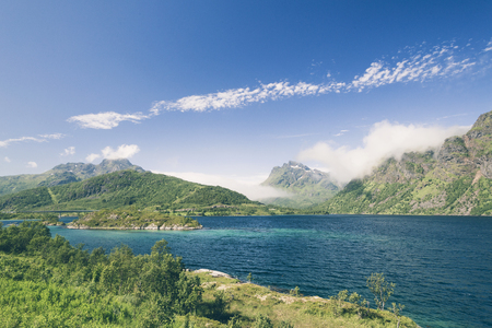 Beautiful North Norway fjord landscape with blue water and green mountains in Lofoten. Stockfoto
