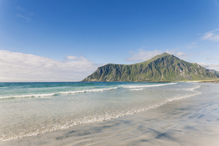 Flakstad beach in Lofoten islands. Turquoise water and white sand, ocean coast.