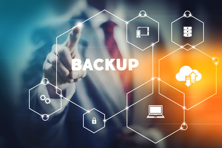Data security backup concept business man selecting word from modern virtual interface Stockfoto