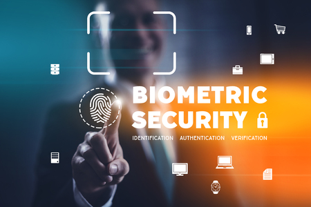 Biometric security concept with fingerprint identification scan and facial recognition. Businessman selecting modern interface. Stockfoto