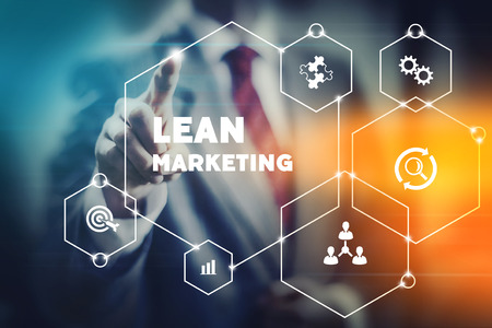 Business leader presenting and selecting lean marketing actions for modern marketers. Stockfoto