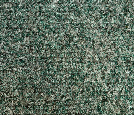 rug texture: Old greenwhite rug texture.