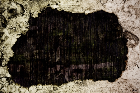 burned out: Grunge edges and a carved out burned hole in the middle with wooden texture  Stock Photo