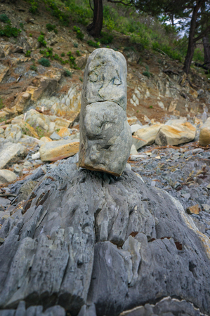 inclusions: Funny rock sandstone figure found on the shore of the Black Sea