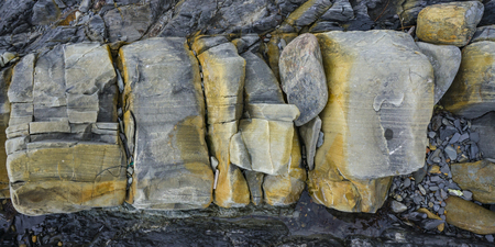 inclusions: Texture of sandstoneThe surface of the large fragment of sandstone boulders Stock Photo