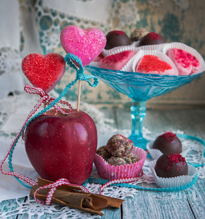 impregnated: chocolate candy apples, homemade impregnated with calvados Stock Photo