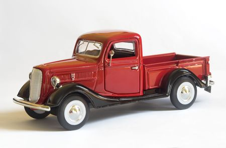 Red model of a Ford Pickup Truck (1937) photographed on white background