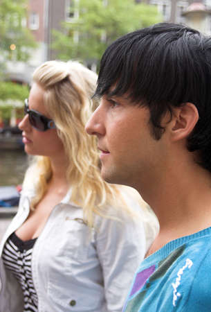 profile portrait of a young adult couple outdoors photo