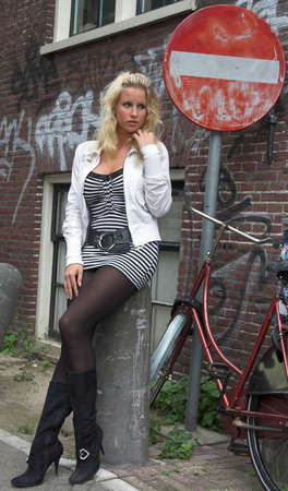 hooker: pretty blonde standing at a ghetto street Stock Photo