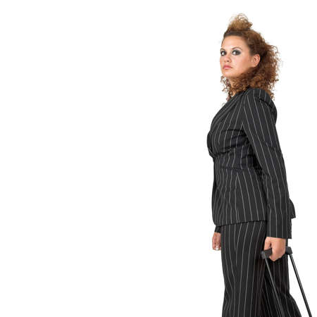 Businesswoman pulling her luggage, isolated on white background; copy space. Stock Photo - 1165643