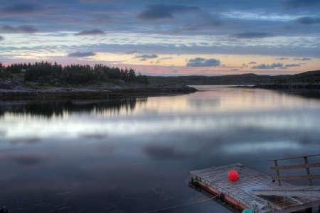 floating fisherman pier in sunset - in a Norwegian fjord. Reklamní fotografie