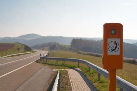 Emergency phone booth on a country road in Germany Stock Photo