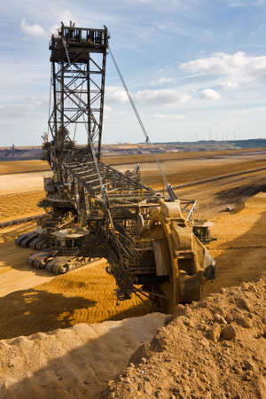 Giant bucket wheel excavator taking away the layers of ground before digging the brown coal. Reklamní fotografie