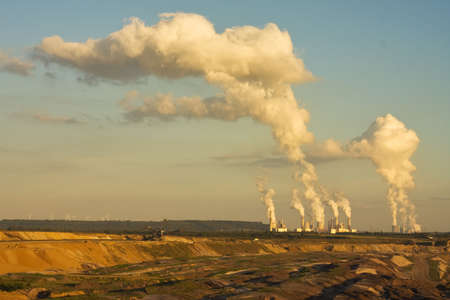 lignite: Open-pit mining for lignite (brown coal) that is burnt and tranformed to electricity by the power stations at the horizon - largest mining sites and power production site in Germany Stock Photo