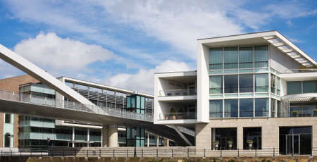 Modern buildings on the riverside of Maas river in Maastricht