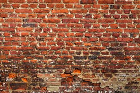 stucco wall: Grunge red brick texture (very old wall)