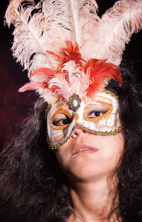 plumage: Brunette woman wearing carnival mask with plumage