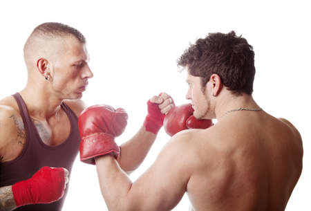boxing match: two muscular men boxing; isolated on white