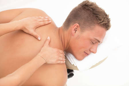 rubdown: Young blond man enoying massage session in spa resort