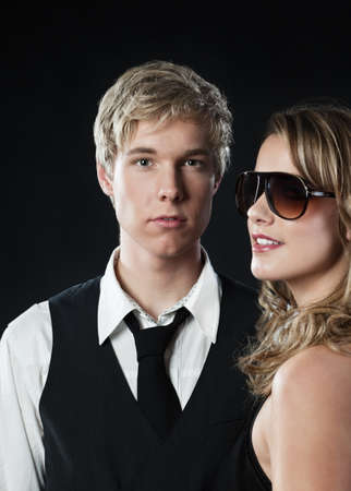 dark blond: Young blond handsome man and pretty blond woman in sunglasses Stock Photo