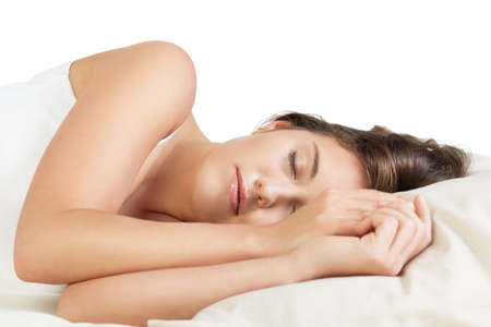 Attractive young woman sleeping against white background Stock Photo