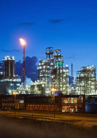 eventide: Illuminated petrochemical plant in twilight (Antwerp port, Belgium) Stock Photo