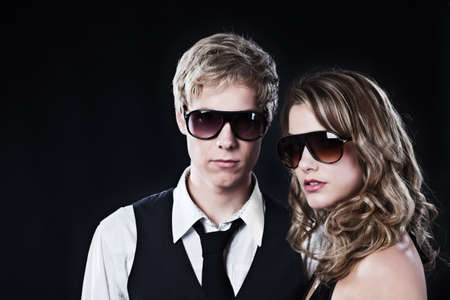 Young handsome man and young pretty woman in sunglasses photo