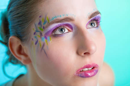 Closeup portrait of a pretty young woman with face art Stock Photo - 9546761