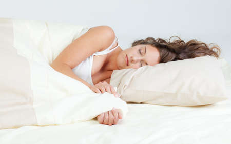 Pretty young woman sleeps in her bed Stock Photo - 10821500