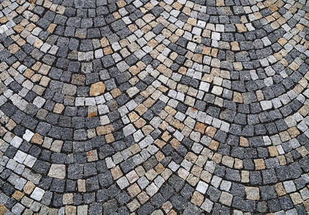 interstice: Closeup view on a cobblestone road - pattern - background