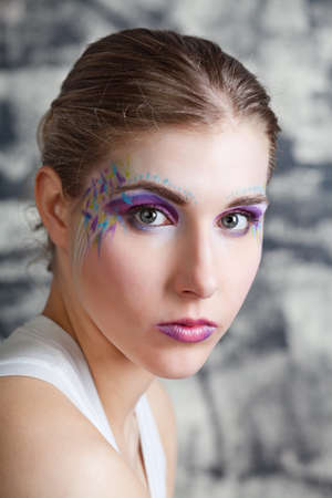 subtlety: portrait of a pretty young woman with face art