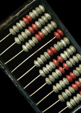 computations: Old abacus on black background.