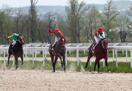 PYATIGORSK, RUSSIA - MAY 9: The race for the prize of the  65 anniversaries of the Victory.Jokey Saitgaleev,Paduchev,Pshukov.May 9 2010 in Pyatigorsk, Caucasus, Russia. Stock Photo - 6913421