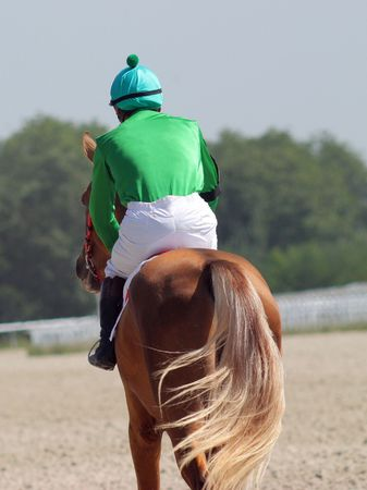 pyatigorsk: The jockey and akhal-teke stallion.Hippodrome in city Pyatigorsk,Caucasus,Russia. Stock Photo