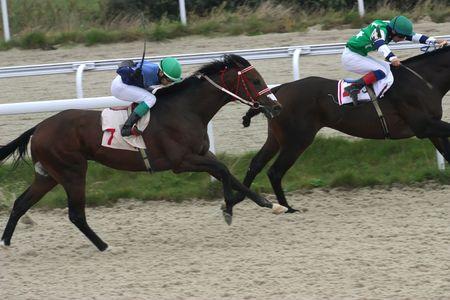 PYATIGORSK, RUSSIA - SEPTEMBER 26: The race for the prize of the Grand Kriterium;The jockey Hamizov and Ulubaev.September 26, 2010 in Pyatigorsk; Caucasus; Russia.  Stock Photo - 7863716