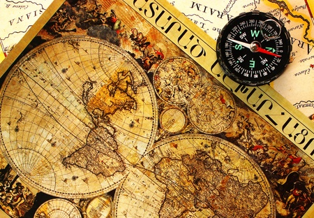 Old paper world map and a compass, Armenia.