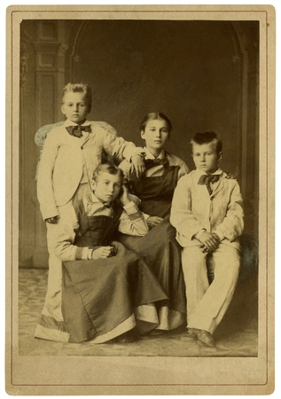 Family portrait, people of all ages, circa 1914.