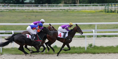 PYATIGORSK, RUSSIA - JUNE 19:Jockeys (L - R) Imran Mardanov,Rinat hamidulin and Timur Guseinov.The race for the prize of the Letni on June 19, 2011 in Pyatigorsk, Caucasus, Russia. Stock Photo - 9761185
