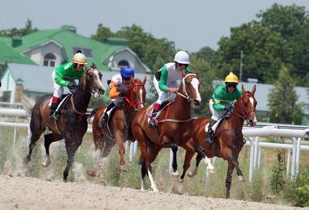 PYATIGORSK, RUSSIA - JULY 17: Jockeys (L - R) Imran Mardanov,Ilgiz Saitgaleev, Eduard Batirov and Aslan Kardanov race for the prize of Ogranichitelni hippodroma on July 17, 2011 in Pyatigorsk, Caucasus, Russia.