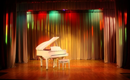 Grand piano in the beautiful interior of the hall photo