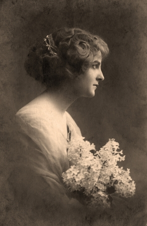 Vintage portrait of a young girl. The shot was taken around 1912 year.