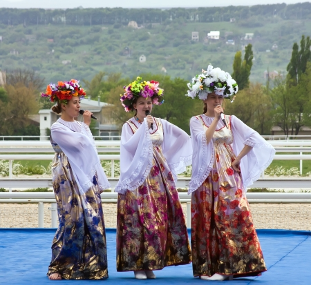 pyatigorsk: Choir of young girls singing at the opening of the racing season in Pyatigorsk, Caucasus. Stock Photo