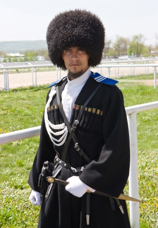A portrait of a young man in a russian cossack uniform in Pyatigorsk,Caucasus