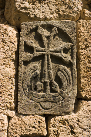 apostolic: The ancient Khachkar in wall - carved memorial stone, Armenia